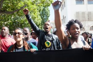 CAPE TOWN, SOUTH AFRICA - SEPTEMBER 01: A group of students shout slogans and hold banners during an anti-xenophobia demonstration against the alleged racist attitude of the administration of the Stellenbosch University in Cape Town, South Africa on September 01, 2015. (Photo by Ashraf Hendricks/Anadolu Agency/Getty Images)
